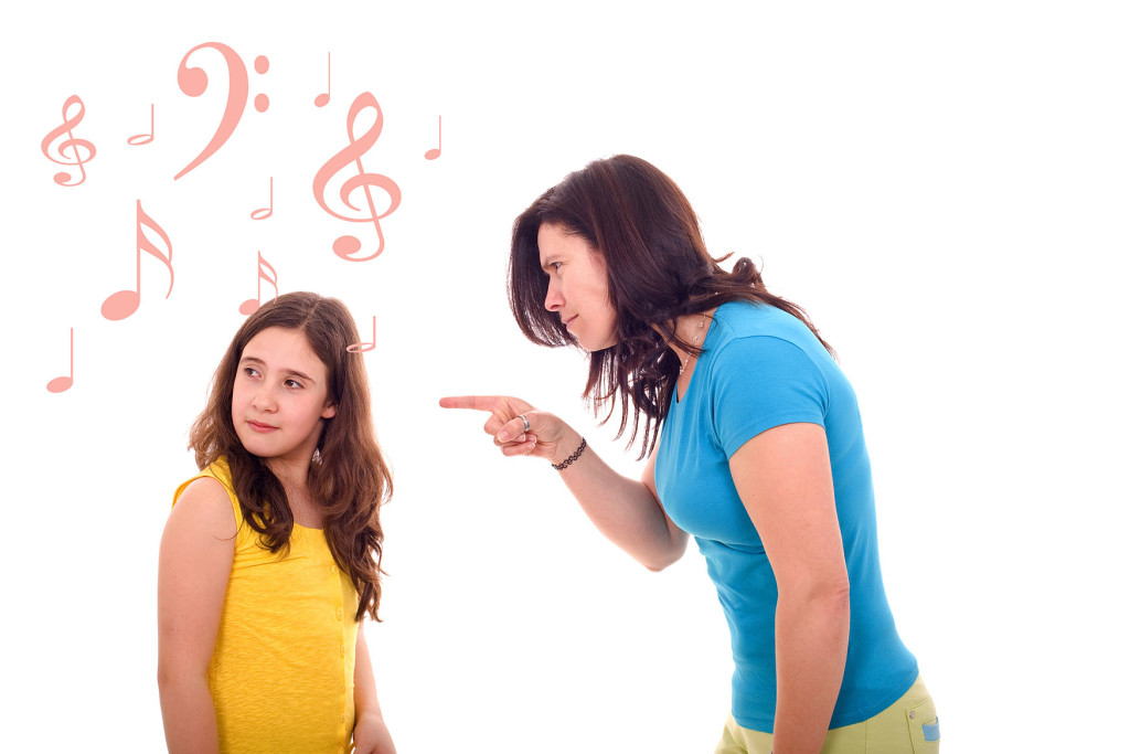 furious mother yelling at her daughter that pretends listening music